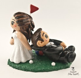 Bride dragging her golfing groom cake topper
