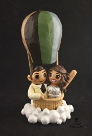 Bride And Groom Riding In A Hot Air Balloon Cake Topper