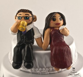 Bride and Groom Sitting On Cake, Eating and Drinking Beer Cake Topper