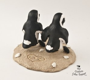 Penguins Walking on the Beach Cake Topper