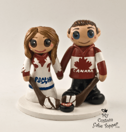 Bride and Groom Hockey Fans Holding Hands Cake Topper