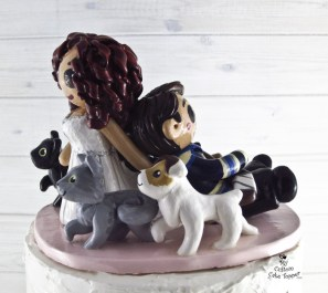 Bride Dragging Groom Surrounded by Pets Cake Topper