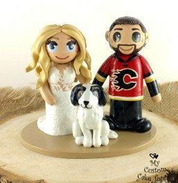 Bride and Groom Holding Hands with Dog Cake Topper