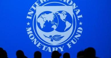 IMF lowers 2020 2021 forecast