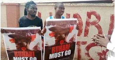 Two Arrested With 'Buhari Must Go Posters
