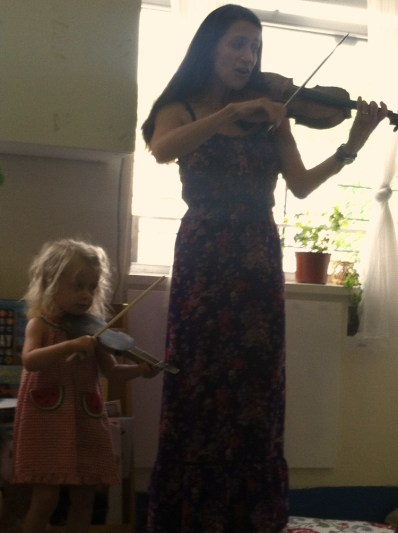 Heather teaching Daisy violin