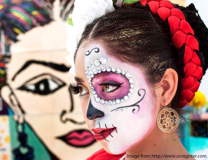 """Mary Triana, 16, wears an intricate Day Of The Dead face at the first annual """"Viva la Vida"""" festival at the Santa Ana train station. ///ADDITIONAL INFO: - Day.of.the.dead.train.1102- shot 110115 - ANA VENEGAS, ORANGE COUNTY REGISTER The first annual """"Viva la Vida"""" festival was a celebration of Day of the Dead (Dia De Los Muertos) at the Santa Ana Train Station. The event featured individual alters to ancestors, food and entertainment."""