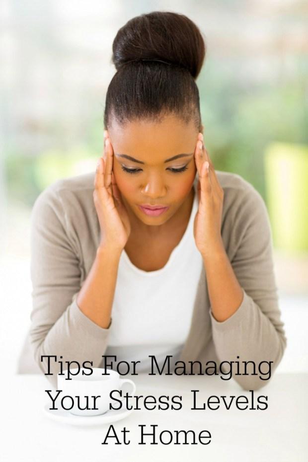 stressed african woman having headache
