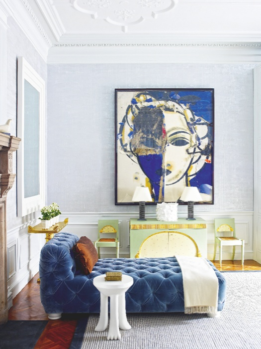 Love the art and blue velvet upholstered furniture against the light blue/grey walls, it just works.  If you have a room that gets a lot of sun, cool it down with blue or other cool colours. Image from revistaaxxis.com.ca