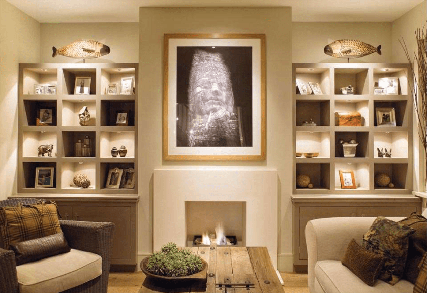 This room features accent lighting but it does just that accents the art and pieces in the shelving rather than drawing your eye to the beam. Accent lighting is done well when you don't notice the beam or light but the featured piece instead. Another lovely example of warm lighting too.