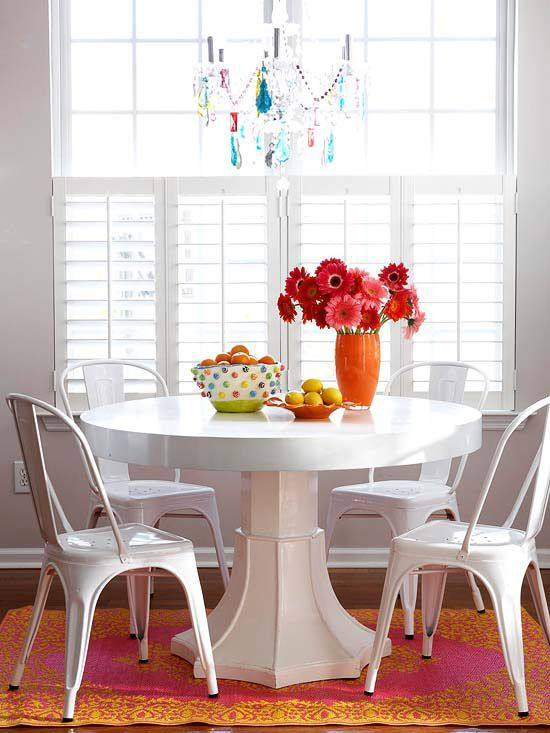 White dining room with splashes of color