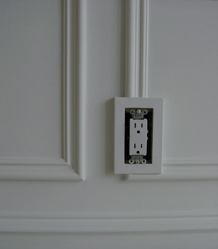 wall trim around electrical outlet box