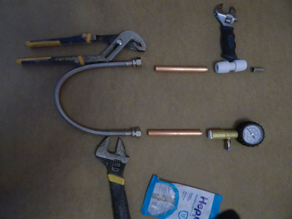 This is generally how it all goes together - ignore the spanners they're just to keep it in shape - DIY pipe testing tool