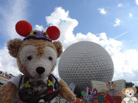 Duffy the Disney Bear takes his picture in front of Spaceship Earth in EPCOT