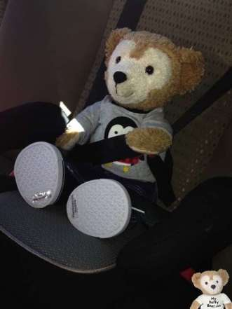 Duffy the Disney Bear is strapped into his Car Seat