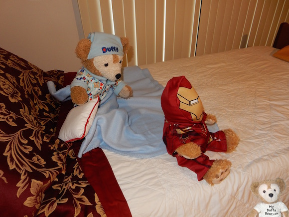 Duffy the Disney Bear reaches to catch Little Joe wearing his Build-A-Bear Iron Man Costume