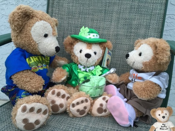Duffy the Disney Bear serves up some lime sherbet to the Little Leprechaun.