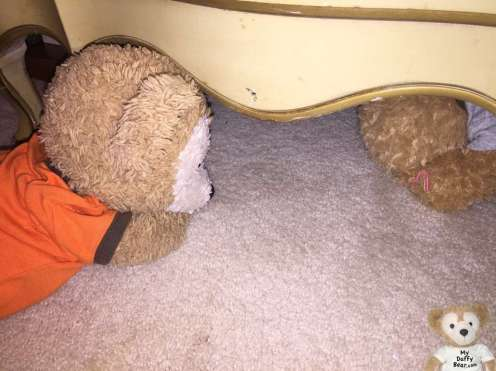 Duffy the Disney Bear tries to coax Little Joe out from under the dresser