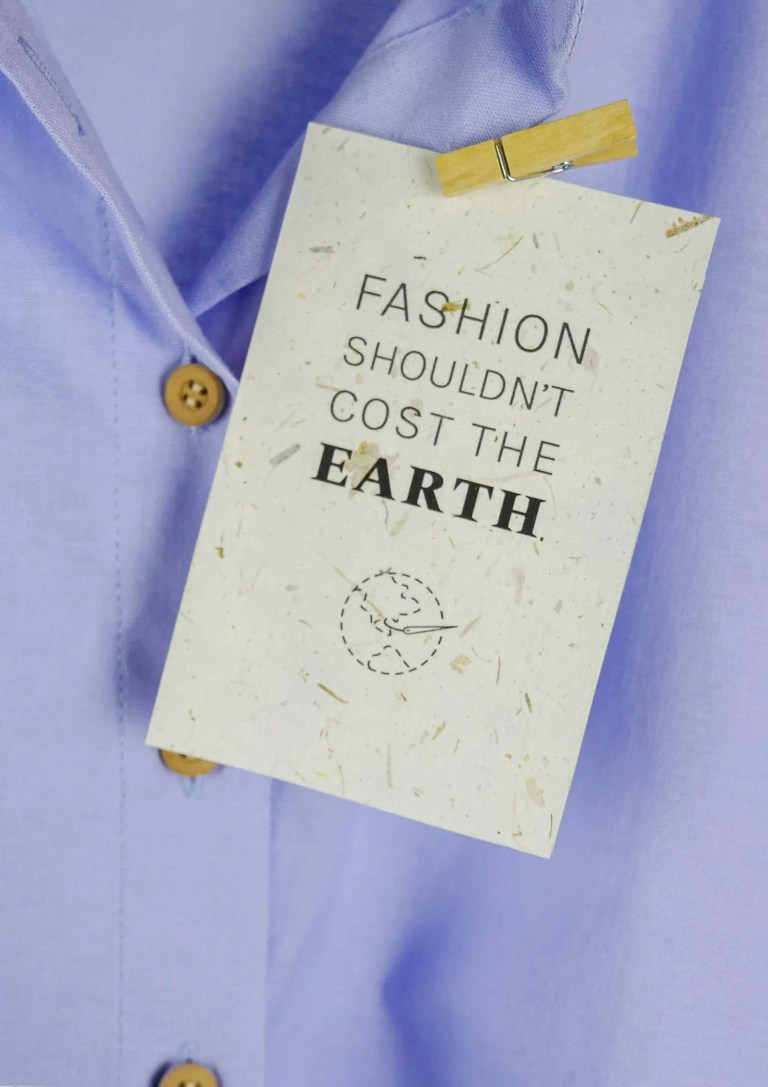 recycled paper card saying that fashion should not cost the earth