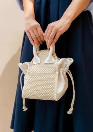 Woman carrying small handmade bag made from organic cotton and natural hemp