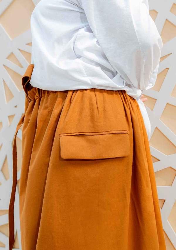 Side pocket on orange cotton trousers