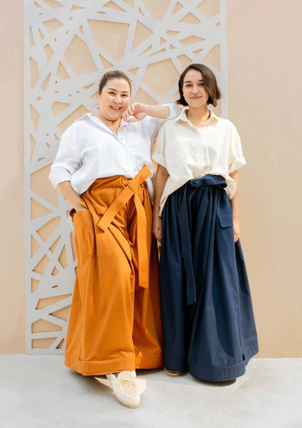 Friends wearing oversized cotton trousers made from organic and recycled cotton