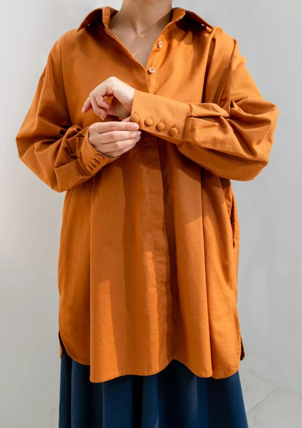 woman wearing long orange cotton shirt