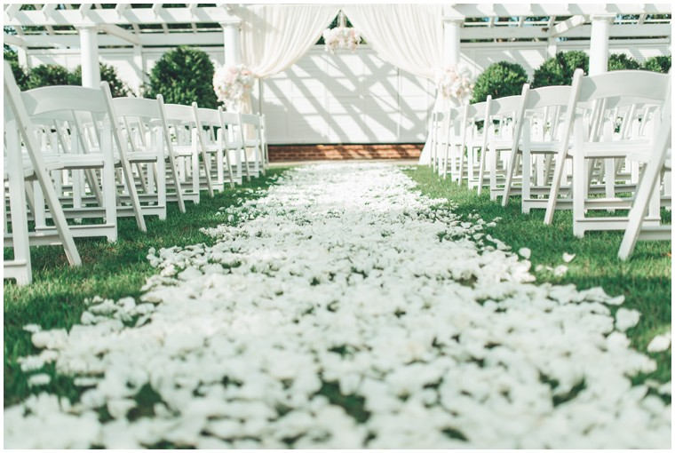 white rose petal ceremony aisle