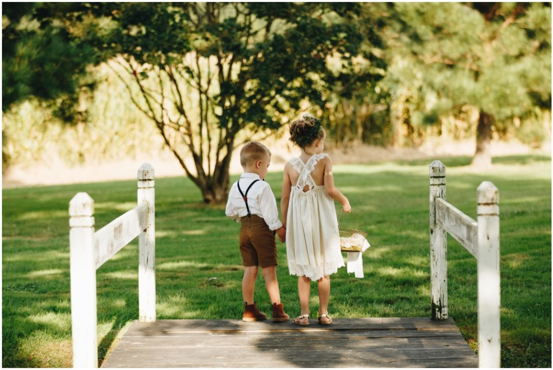 Flower girl in white flowy dress and ring bearer in a button up shirt and shorts. |Eastern Shore Wedding|
