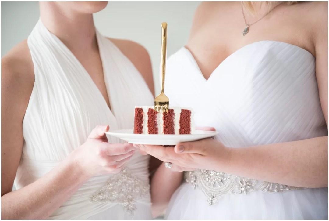 Brides Hold Wedding Cake