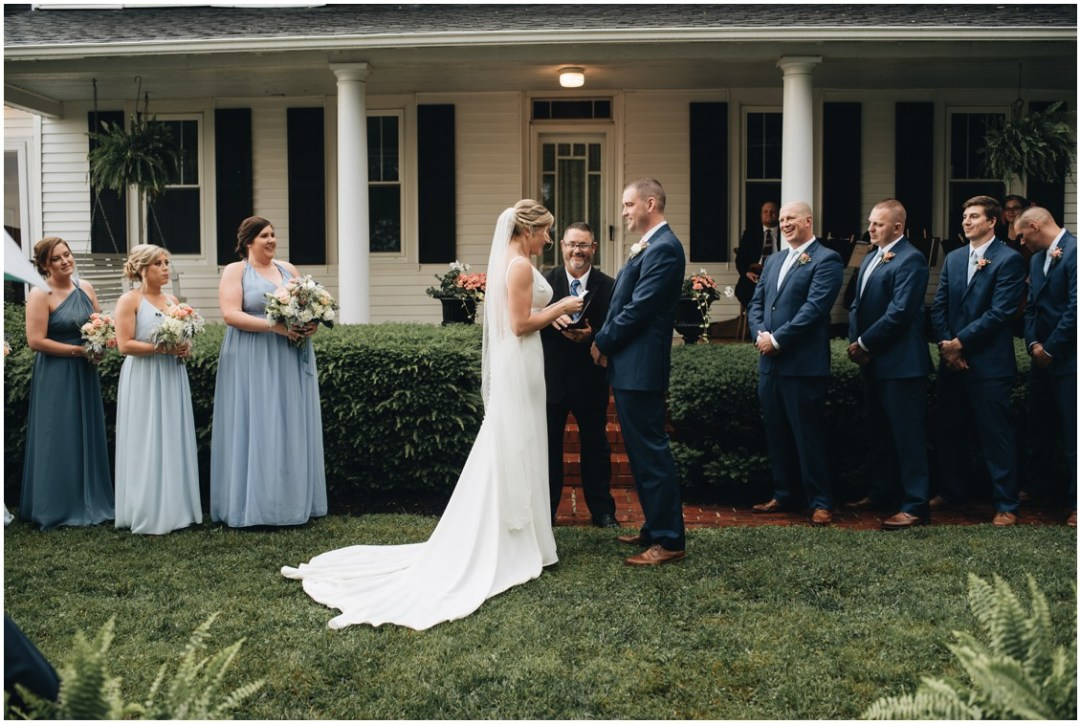 Rainy wedding ceremony in front of a white house. | My Eastern Shore Wedding |