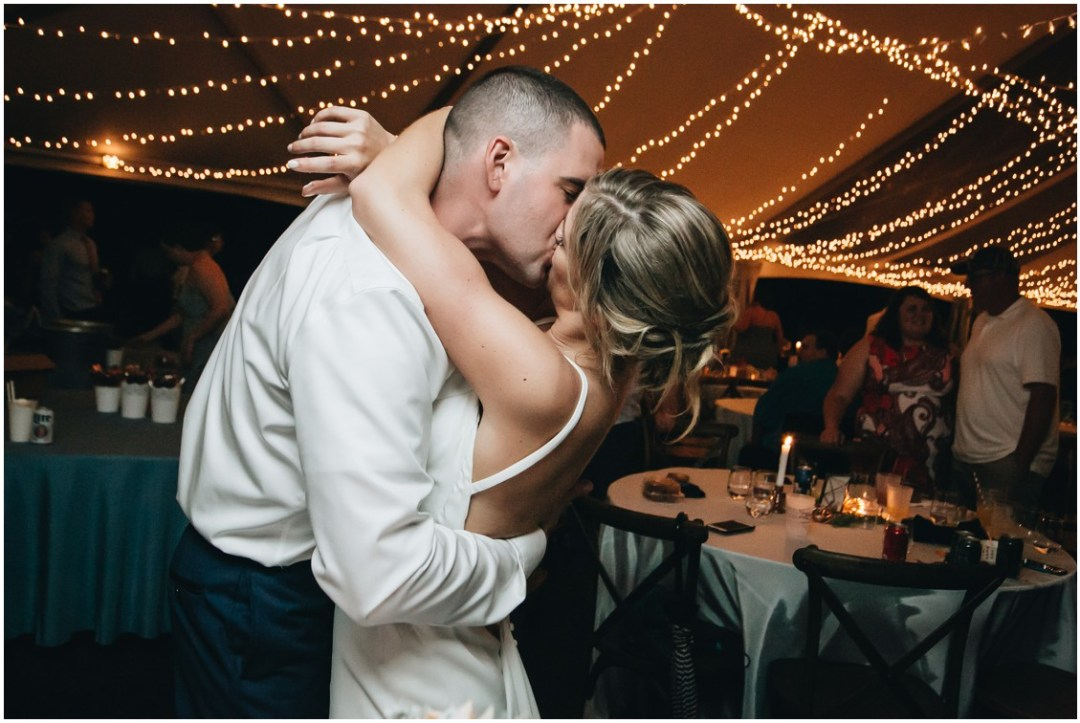Bride and groom kissing at wedding reception. | My Eastern Shore Wedding |
