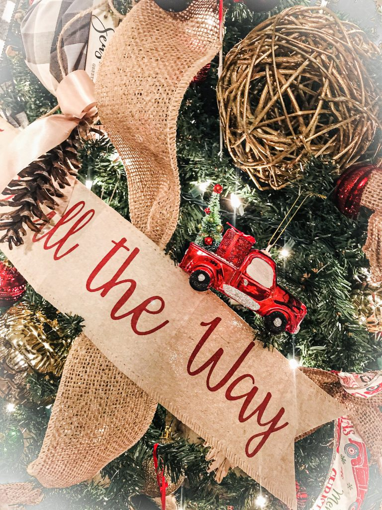 jingle all the way banner and red truck ornament