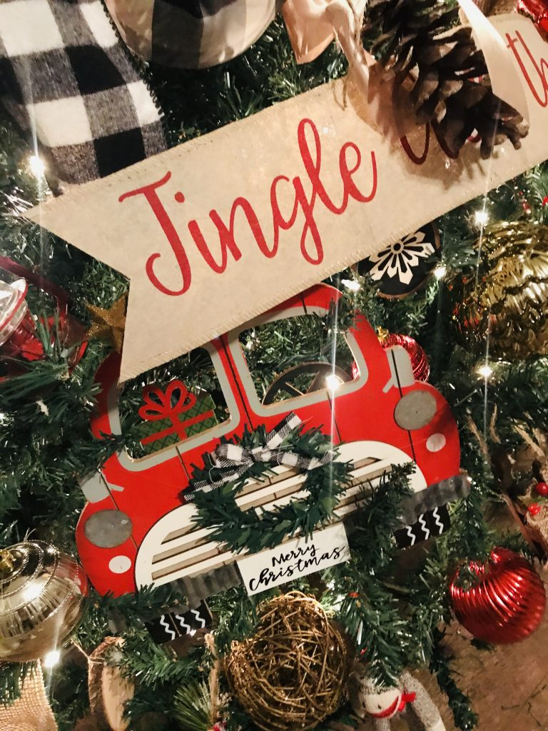 Red truck wooden sign used as a jumbo ornament