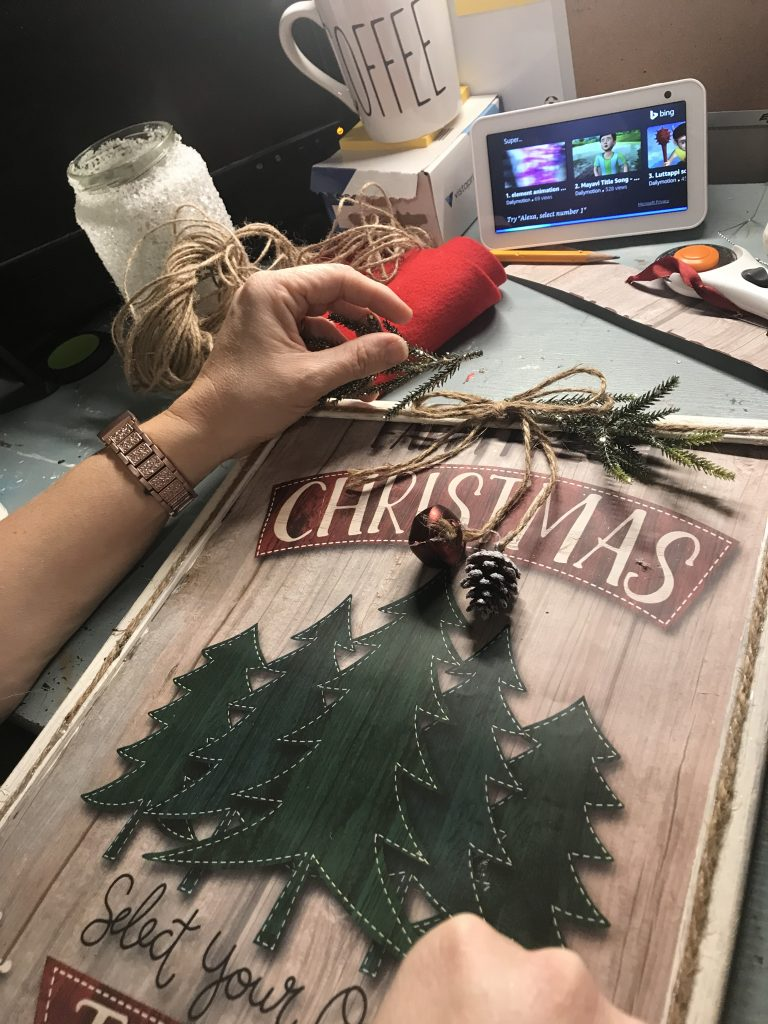 adding embellishments to Christmas frame