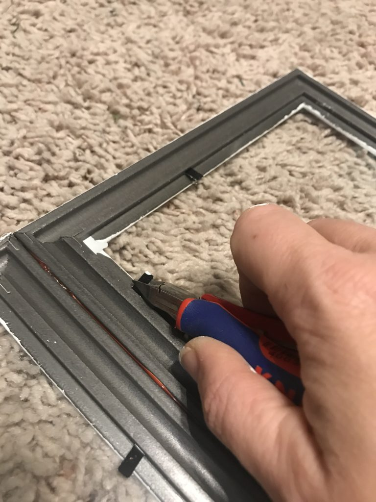 removing the metal tabs from the frames