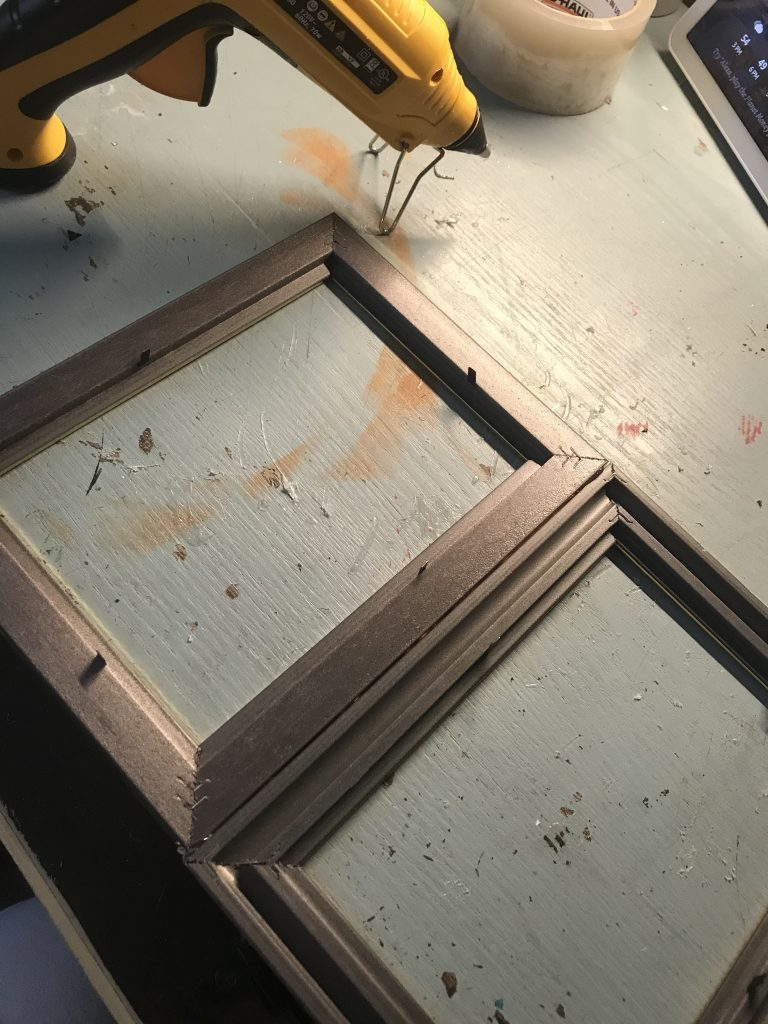 gluing the frames together with hot glue