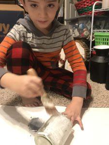 painting glass jar with mod podge