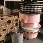 spools of pink, black, gray, and white ribbon
