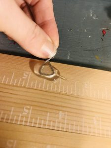 gluing hanger onto paint stick wall hanging