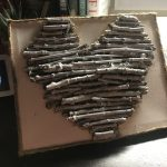 painting white on a twig heart