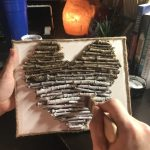 painting white on twig heart