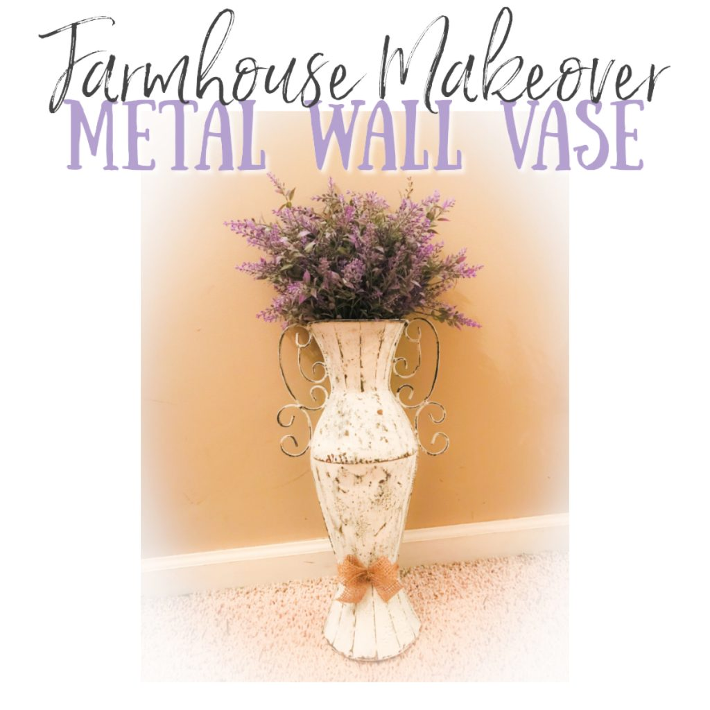 metal wall vase painted with added lavender and burlap ribbon