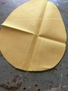 yellow fabric egg cutout