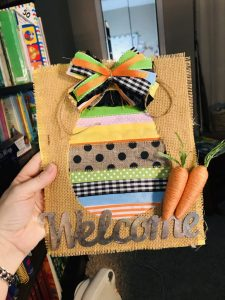 adding twine carrots to ribbon easter egg canvas