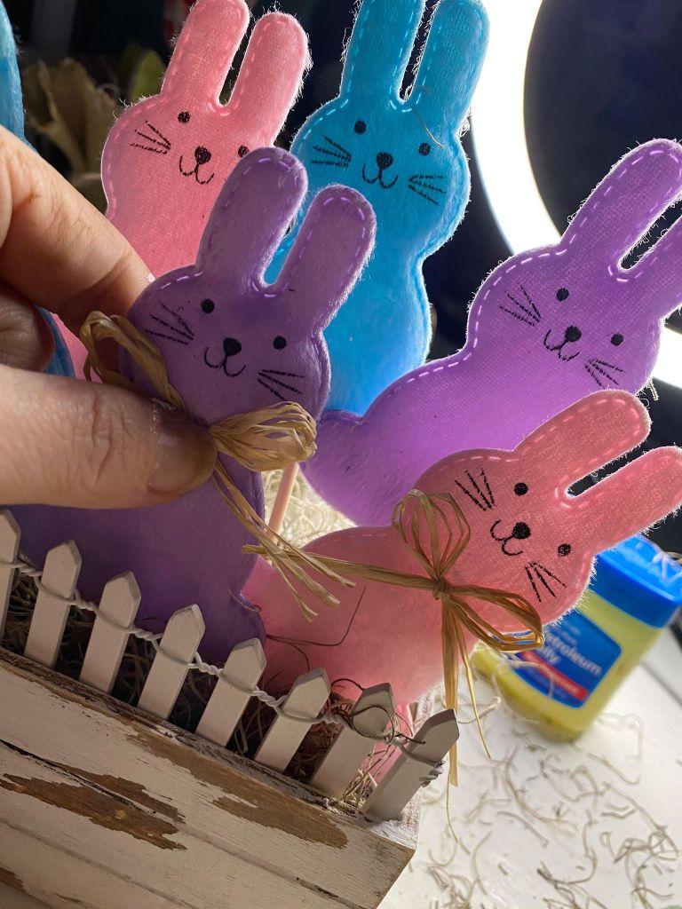 adding raffia bows to bunnies