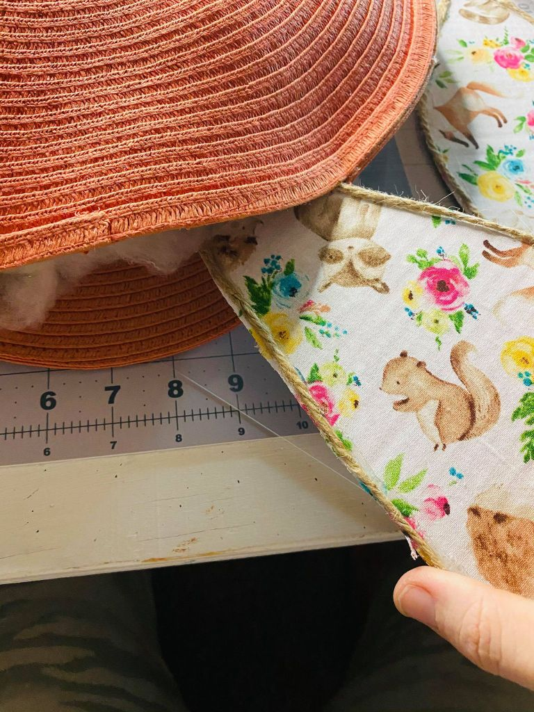 adding ears to a stuffed placemat pillow