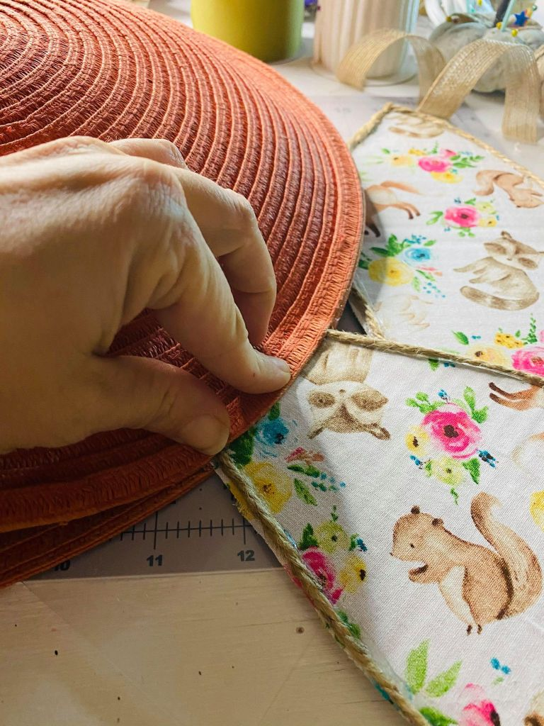 Gluing down ears inside of a placemat pillow