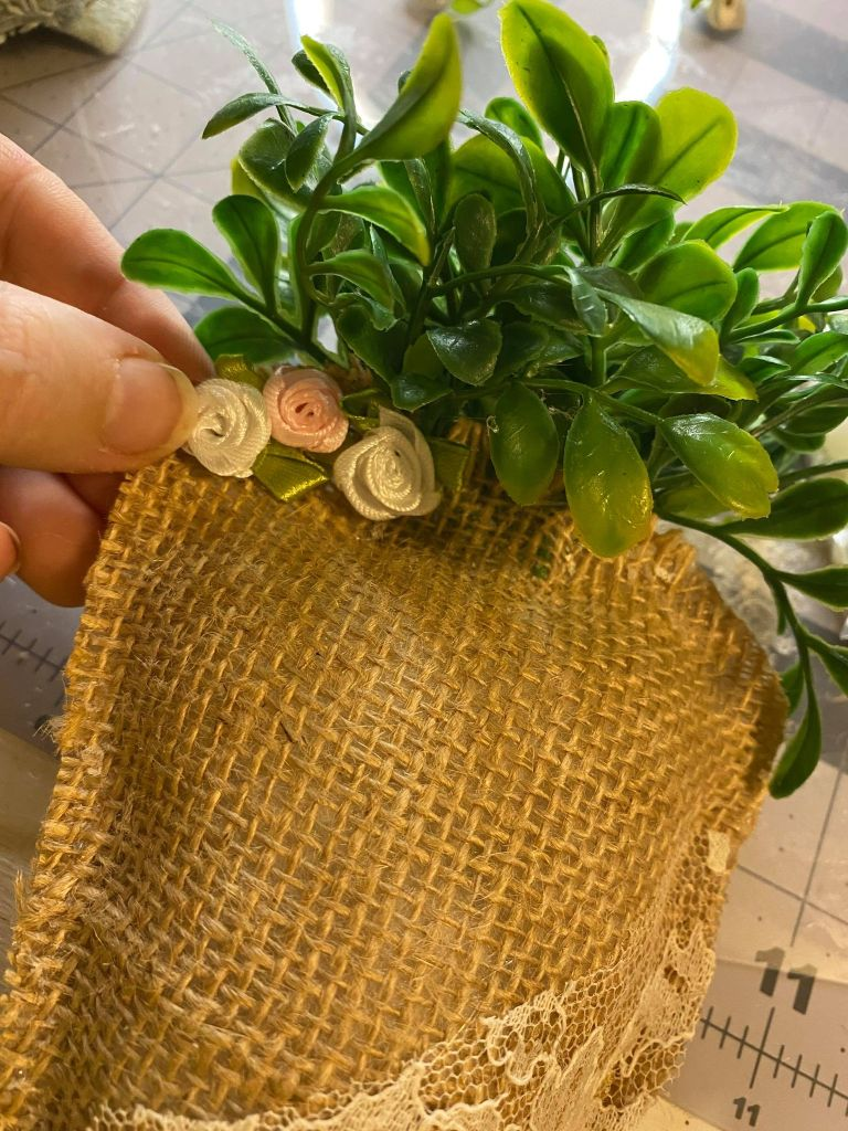 adding rosettes to a burlap carrot