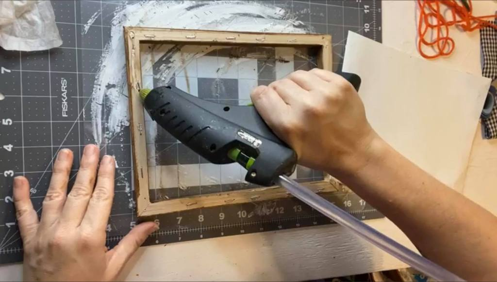 gluing the canvas back onto a frame